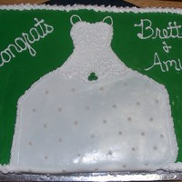 Bridal Shower Cake White and Strawberry cake with green fondant and the wedding dress is fondant.