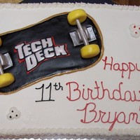 Skateboard Cake Teck Deck fondant skateboard. White and Strawberry cake with bbc icing.