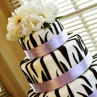 Another Zebra Cake This is my second request for a zebra wedding cake...maybe it's a new trend? All fondant with real ribbon and real flowers. Thanks for...