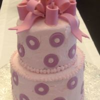 "Pink Birthday Cake   8"", 6"" buttercream with fondant bow and polka dots."