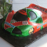 Race Car Grooms Cake This cake was based off of a Mazda race car that the groom loves. WACSC with buttercream covered in fondant and hand painted with food...