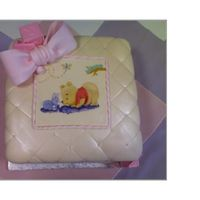 Baby Shower Baby Pooh Fondant covered with Pearl spray and hand painted Pooh sceen. I quilted the fontant with the edge of a ruller so it is not lined up perfect...