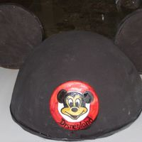 "Mickey Mouse Ears Carved from 1x10"" and 1x 8"" round cake, covered in SMBC and black fondant- ears are made of chocolate colored black and fondant-..."