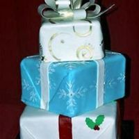Stacked Christmas/holiday Gifts covered in fondant with white chocolate bow.