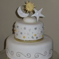 Celestial Theme Bridal Shower Cake This cake is covered in marshmallow fondant. The spirals and dots are piping gel with silver luster dust mixed in. The sun, moon, and star...