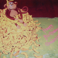 Monkey Business This was so fun to make. banana cake w/cream cheese icing, fondant bananas and monkey. Thanks for looking