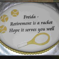 Raquet Cake The cake is covered in MMF. I used transparent vellum paper for the text, adhered with piping gel, and had them remove it before serving.