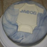 Onesie Cake   This cake is covered with marbled fondant and a marshmallow fondant onesie