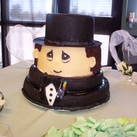 Precious Moments Groom Cake Made out of Fondant, this three-tiered cake was for a bride and groom whose whole theme was precious moments. The main cake had precious...