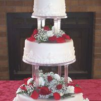 Red Roses 3 tiered round cake covered in fondant with real roses on top