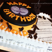 "1268494168.jpg Record is a 10"" round cake on top of 1/2 sheet cake. The guitars and music notes are molded chocolates. The Beatles logo, signatures,..."