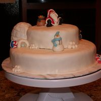 Christmas Cake With Santa, Snowman, Penguins, And An Igloo.