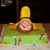 Curious George I did this for a 4 year old's birthday. Curious George is looking out from under the yellow man's hat.