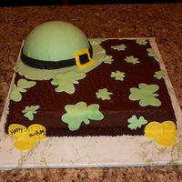 St. Patrick's Day Yellow cake with chocolate frosting. Made for a co-workers brother's birthday. Thanks for looking.