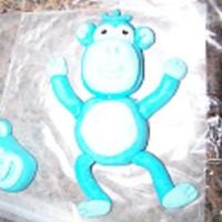 Fondant Monkey-My First I finally tried making a fondant figure last night. He is made with MMF. I am making a cake for a 1st Bday party and the theme is monkeys....
