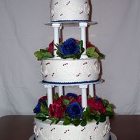 3 Tier Wedding Cake This is one of my first wedding cakes. It is a 6/8/12 white cake with all buttercream icing. Silk flowers are between the layers, but they...