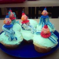 Clowns! My clowns from Wilton Course 1. I don't get to make the final cake (going out of town for work), so I did these instead.