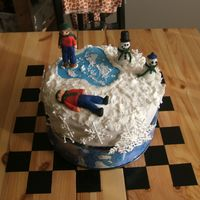 Winter Cake Another first - Royal Icing! Pond and figures are fondant, snow and snowflakes are royal. My figures didn't come out exactly the way I...