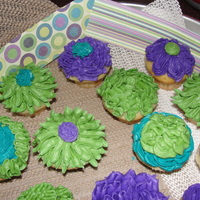 Spring Bridal Shower Mini cupcakes for a spring bridal shower. The paper you see in the back was used by the client to make wrappers for the cuppies, thus the...
