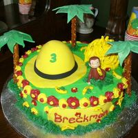 Curious George Birthday  10' half butter, half white cake with buttercream. Trees are fondant and pretzels, bananas are runts marked with edible marker. I...