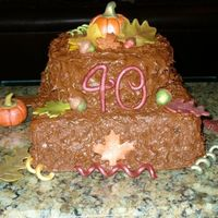 Fall 40Th B-Day Cake 10 in square choc. cake with 8 in round butter cake, choc hot fudge buttercream. My friend wanted a rustic fall themed cake similar to one...