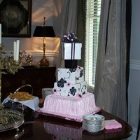 Baby Jane This is a three tier baby shower cake with pink skirting and black brushed embroidering. The box on top was done as a keepsake. The flowers...