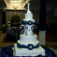 Ramont Wedding This is the tallest cake I have done. It was a lot of fun to design and see come together. The jewelry is real. The scrolls are aluminum...