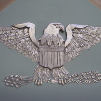 Silver Eagle This eagle was hand done using royal icing. The main body was fondant. It went on the top of a cake at a Colonel's retirement party.