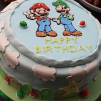 Super Mario Birthday Cake I made this for my nephew Justin's birthday. He and his brother are BIG Super Mario fans. They like to think they are Mario and Luigi...