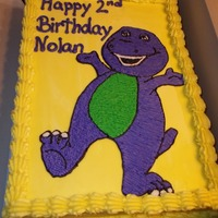 Barney Cake Rainbow cake with buttercream frosting.