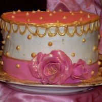 "F_1176870069.jpg Practicing for my daughters wedding. 6"" butter pecan with BC frosting and fondant trimmings , piped with gel and painted with gold..."