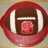 Nc State Wolfpack I made this football cake with the NC State University logo. It was a huge hit at the tailgate for the Meineke Car Care Bowl this past...