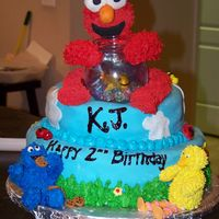 Elmo And Friends Birthday Cake Had an idea of Elmo and Dorothy being on top of the world. Saw a different Elmo cake on here and loved the idea so much, that I had to try...