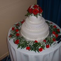 Red Roses Wedding Cake This cake was made in May 2004 using white fondant. The top and bottom tiers displayed a simple pearl pattern, and the middle tier was...