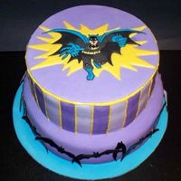 Batman Birthday Cake Batman cake covered in MMF. Fondant plaque on top, and MMF bats around the base tier.