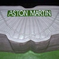 Aston Martin Cake Modelled after the Aston Martin logo.