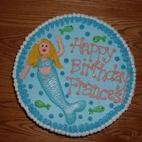 Mermaids Birthday Cake The mermaid is made entirely from fondant, brushed with white and violet lustre dust to giver her a shimmery loonk. The sides of the cake...