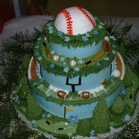 Sports Themed Wedding Cake This cake and all decorations are 100% edible, created for a couple that were married on a baseball diamond. It has a golf course...