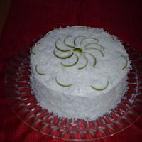 Lemon Coconut Cake Lemon cake with coconut filling. Decorated with Limes peels. So yummy!