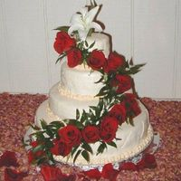 Wedding_1_Sm.jpg This was my first wedding cake, done this past October for a friend's sister. It's 4 tiers, which I had to transport 5 hours to...