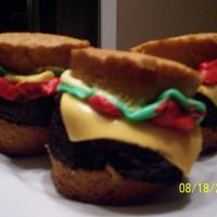 Hamburger Cupcakes For A Bbq  Thank-you Sharon Skates for tutorial. First time making MMF! Cupcake bun and meat patty. Meat patty rolled in chocolate syrup. MMF cheese...