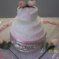 Pink Scroll With Roses Real roses on top, rest is all buttercream, this is my first wedding cake!!!