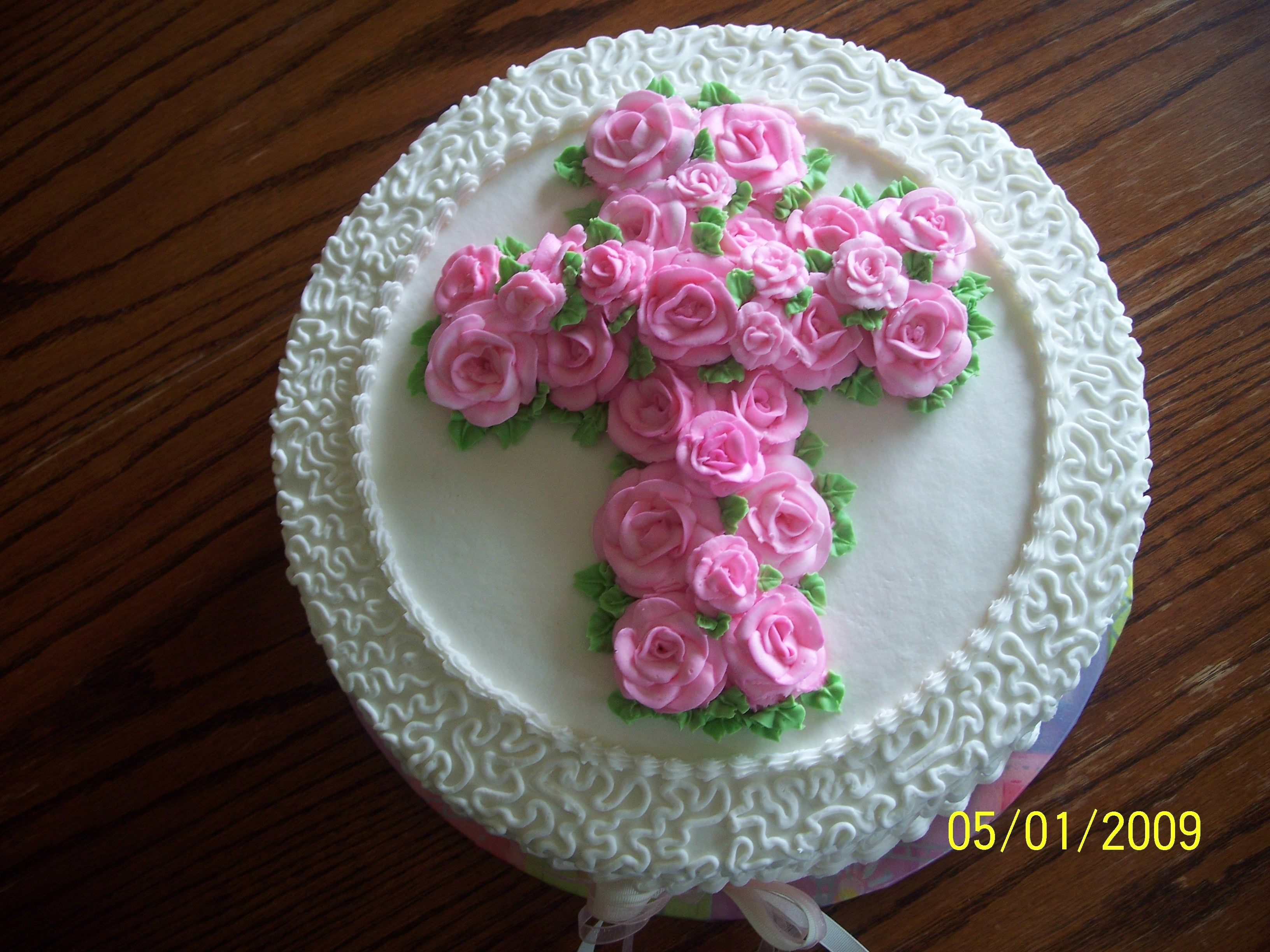 "Communion W/ Pink Roses 12"" White cake w/ raspberry filling, buttercream roses, cornelli lace and ribbons. I LOVED this cake!"