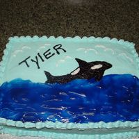Whale Cake This was for a little boy who wanted a 'Whale' cake. It's all buttercream icing with piping gel for the water. I used the...