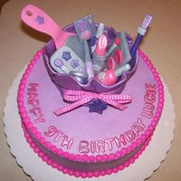 Make Up Cake For Spa Party   Buttercream icing on cake with all fondant makeup and make up bag.