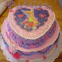 Tinkerbell Birthday Cake I used a Tinkerbell icing transfer for the image and made royal icing flowers for it. The name is made of royal icing, though quite fragile...