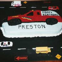 Truck Cake Hard to believe this was from 2001! My husband helped me and decorated the board for me. That was ALL his idea. Still remember making this...
