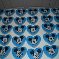 Mickey Mouse Cookies   Favors for my son's second birthday party. Sugar cookies iced with color flow, mickey face also made from color flow.