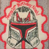 Clone Wars Cupcake Cake  Chocolate cupcake cake (25 cupcakes) with clone wars storm trooper in red (did another one in blue as well). The storm trooper is a FBCT....
