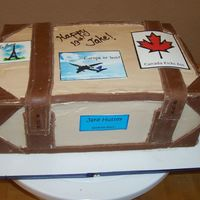 Suitcase Cake Genoise soaked in Kalhua sugar syrup, then layered and finished in mocha swiss meringue buttercream. The leather accents are Toba's...